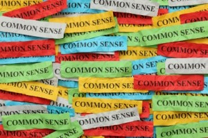 "Pile of colorful paper notes with word ""Common Sense""."